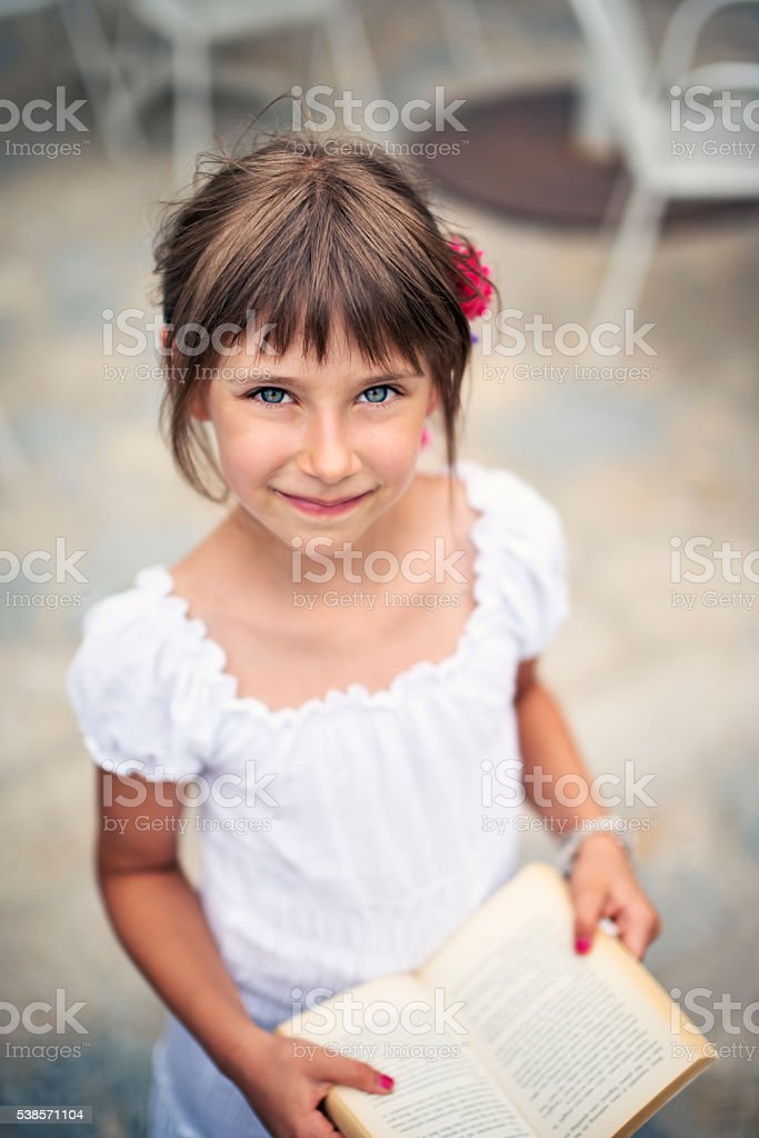Portrait of a little girl with a book stock photo