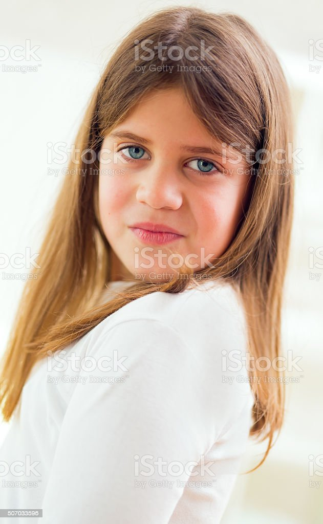 Portrait of a little girl with blue eyes stock photo
