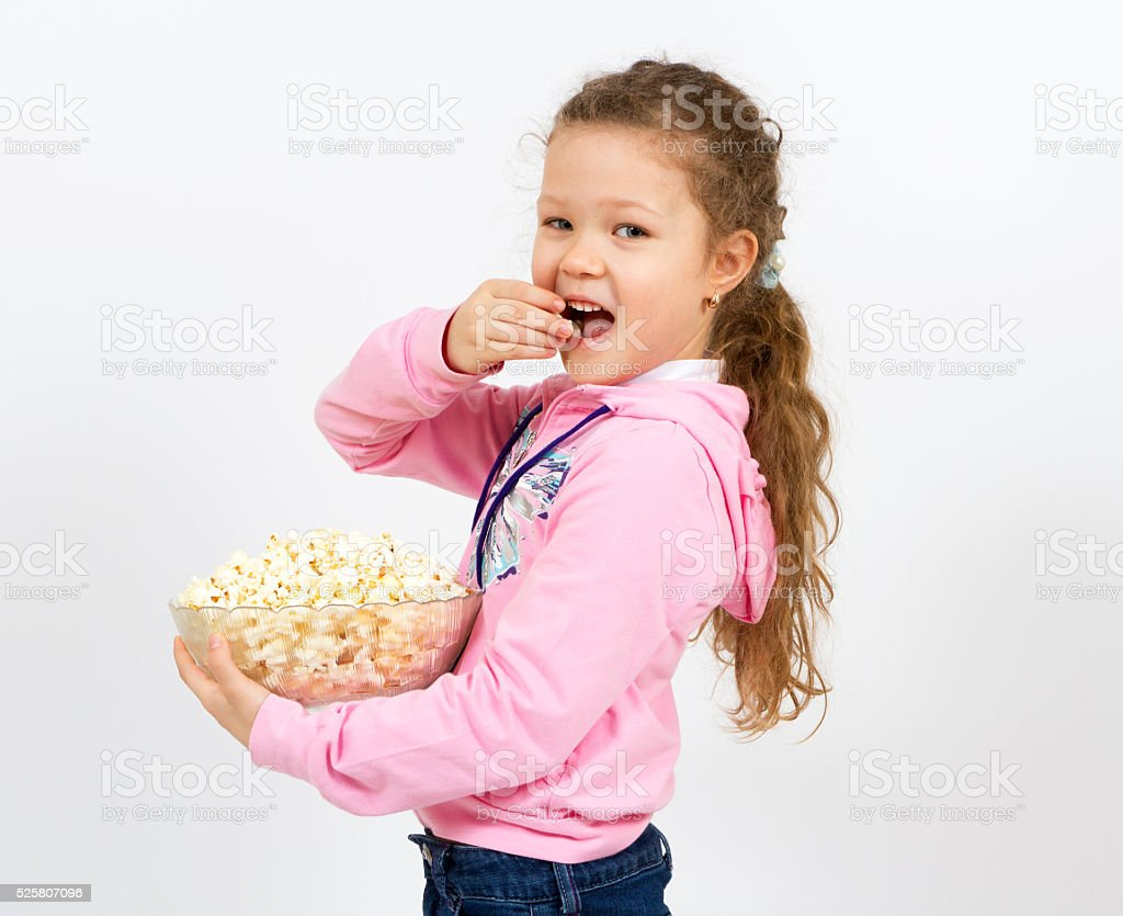Portrait of a little girl with popcorn stock photo
