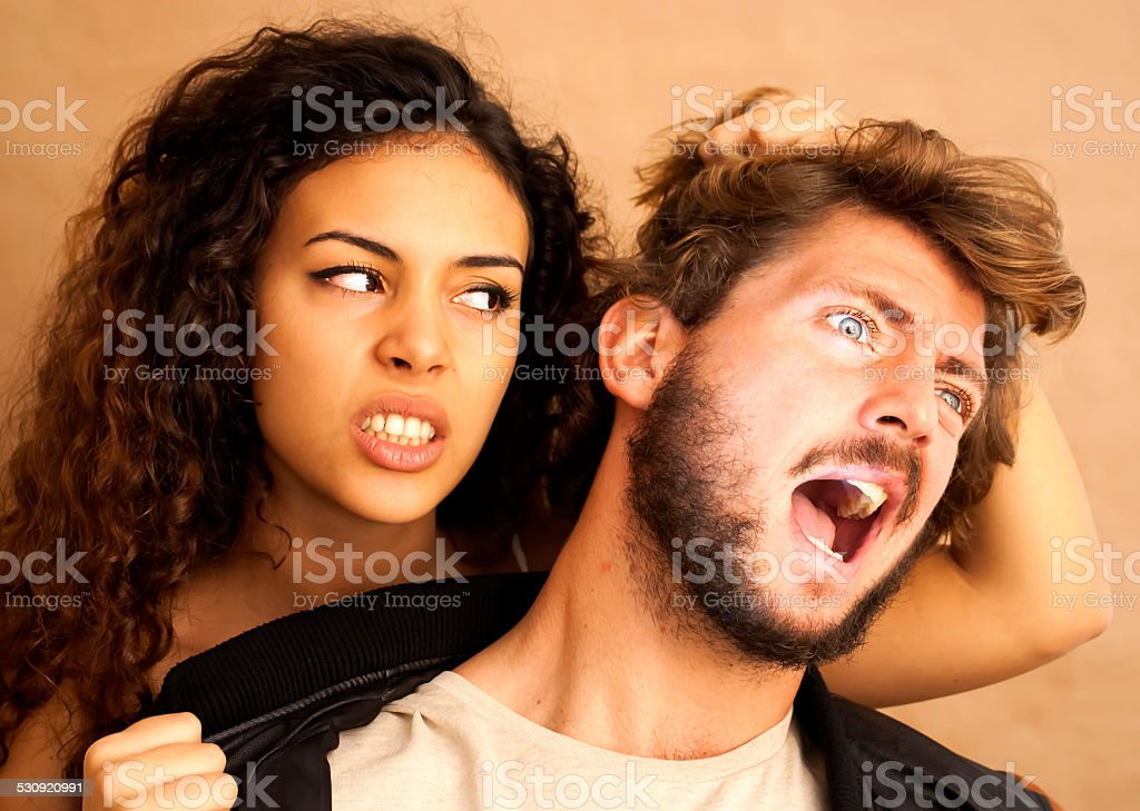 Portrait of a loving couple and She's pulling his hair. stock photo