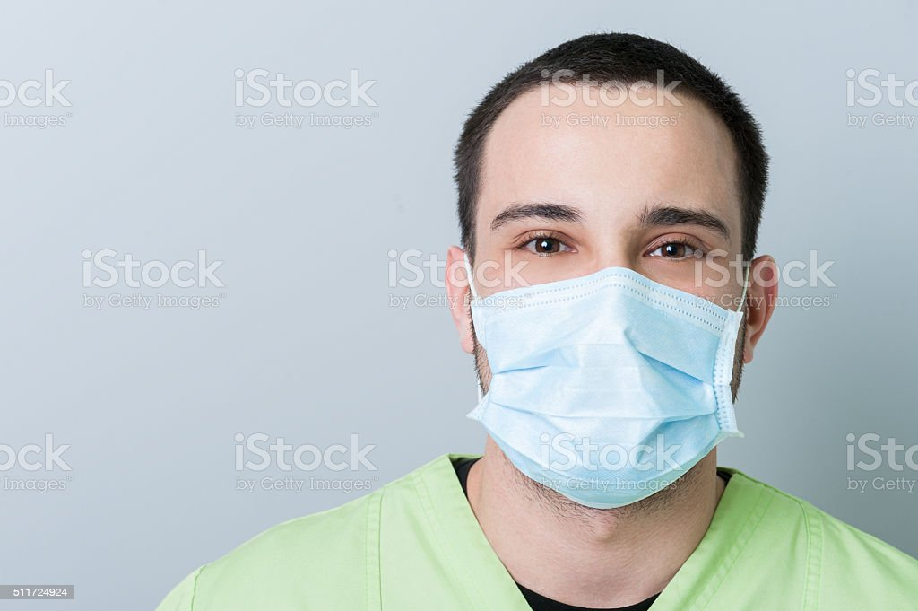 Portrait of a male dentist with copy space stock photo