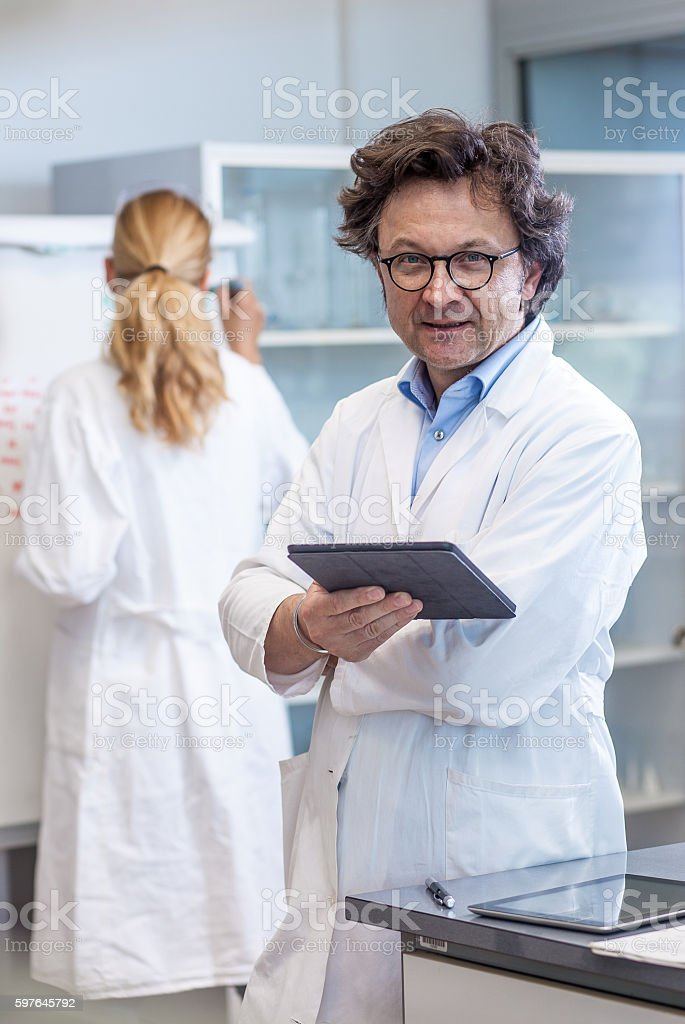 Portrait of a Male Mid Adult Scientist in the Laboratory stock photo