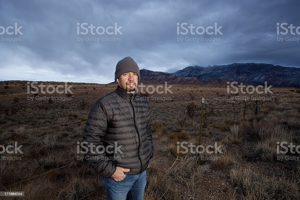 portrait of a man and desert mountain landscape royalty-free stock photo