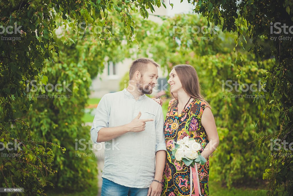 portrait of a man and woman with flowers in nature royalty-free stock photo