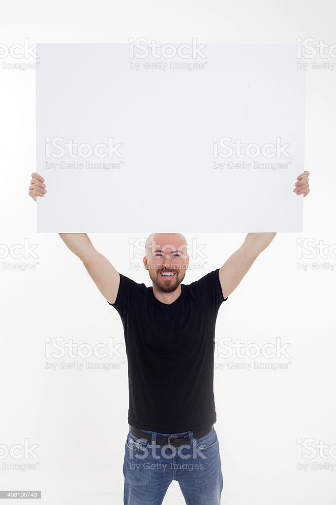 Portrait of a man holding white blank card stock photo