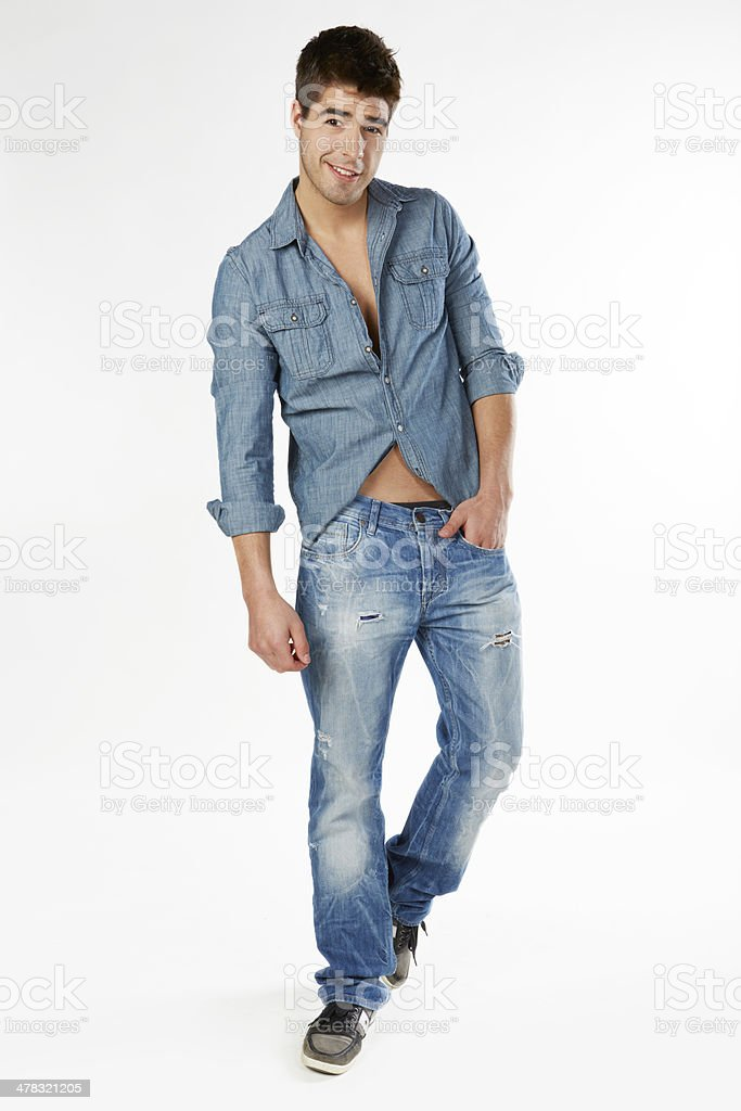 Portrait of a man in casual jeans standing and smiling royalty-free stock photo
