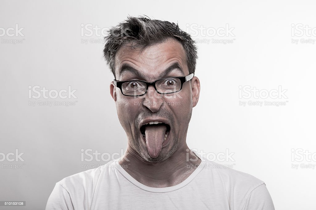 Portrait of a man in disgust poking out his tongue stock photo
