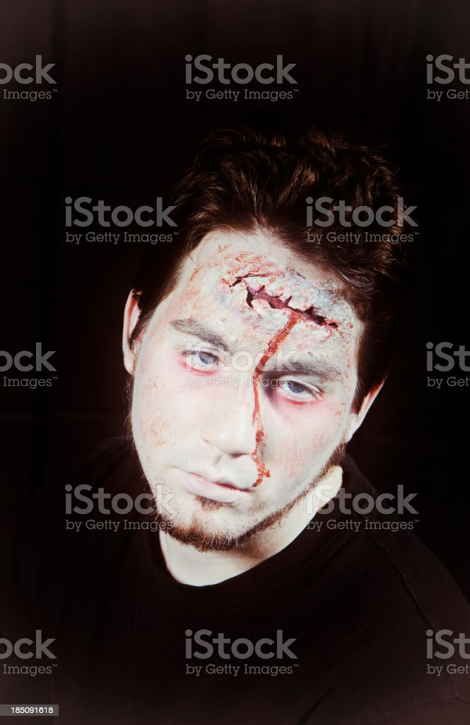 A portrait of a man in zombie makeup royalty-free stock photo