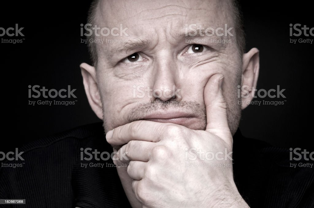 Portrait of a man leaning on his hand royalty-free stock photo
