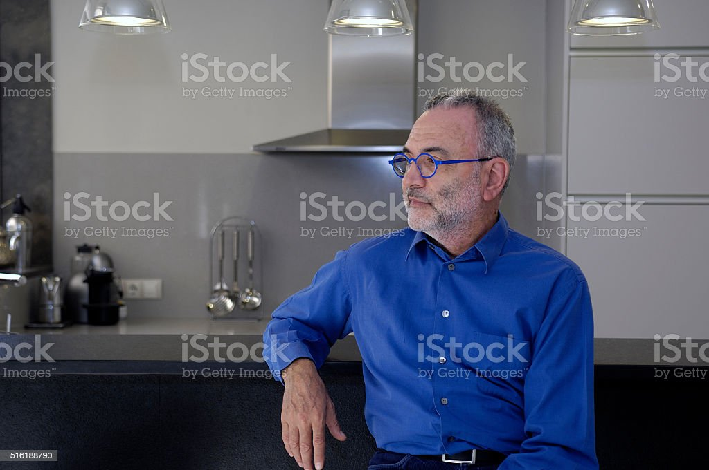 Portrait of a man posing at home stock photo