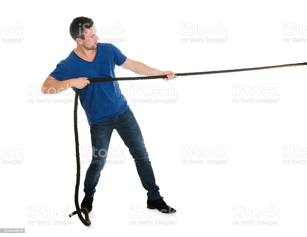 Portrait Of A Man Pulling Rope stock photo