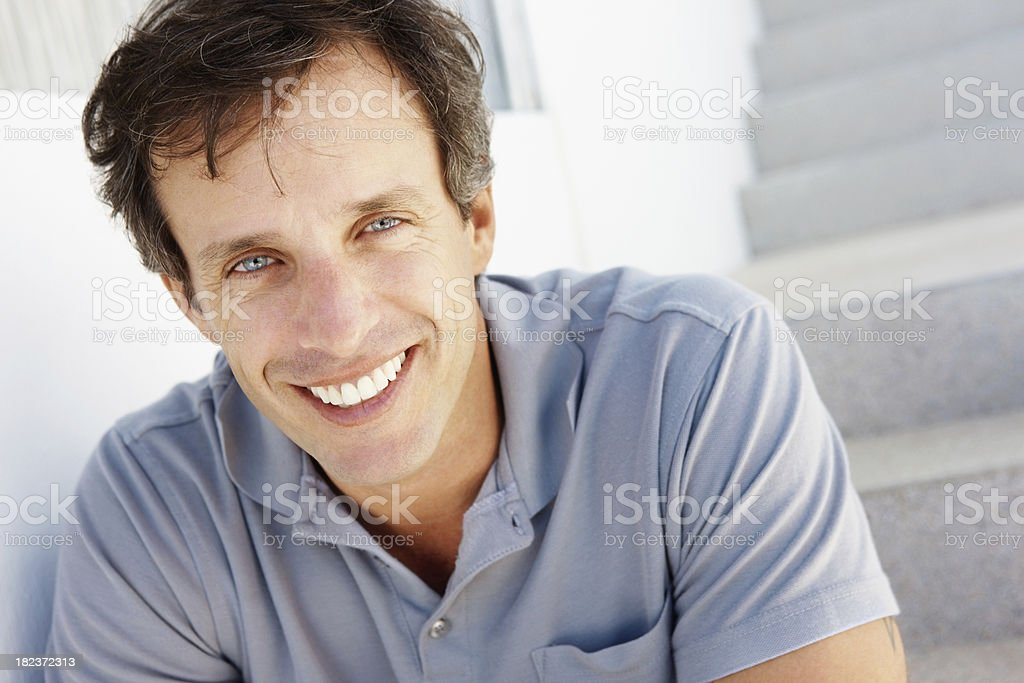 Portrait of a man smiling at home royalty-free stock photo