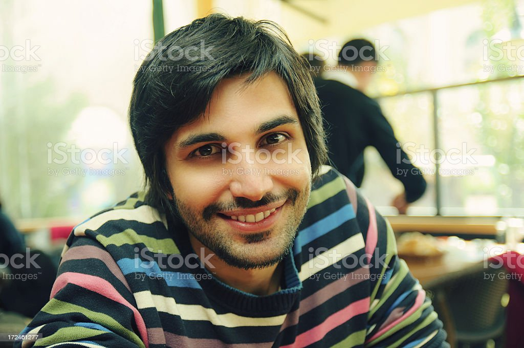 Portrait of a man smiling in a striped colorful shirt royalty-free stock photo