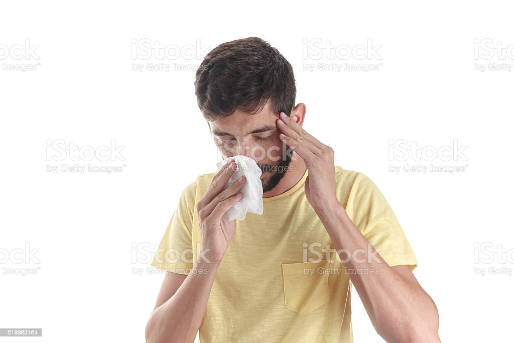 Portrait of a man sneezing with a handkerchief stock photo