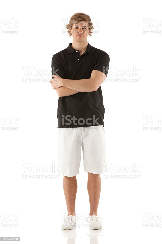 Portrait of a man standing with his arms crossed stock photo