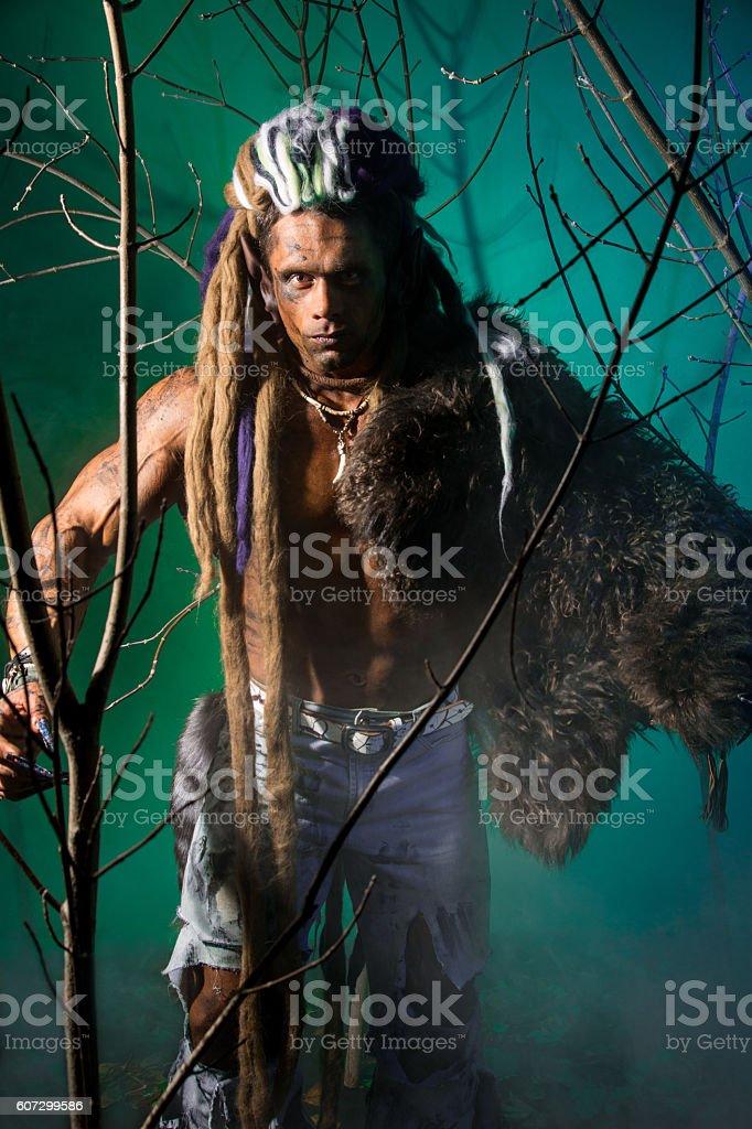 Portrait of a man walking a werewolf stock photo
