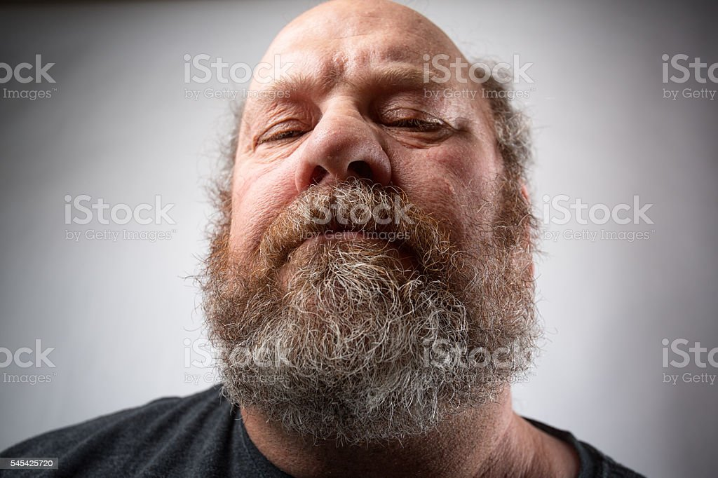 Portrait Of A Man With A Condescending Look stock photo