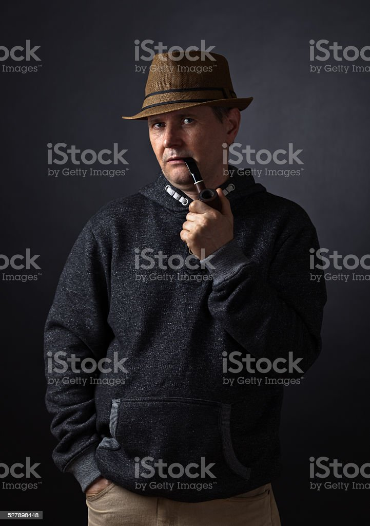 Portrait of a man with a smoking pipe stock photo