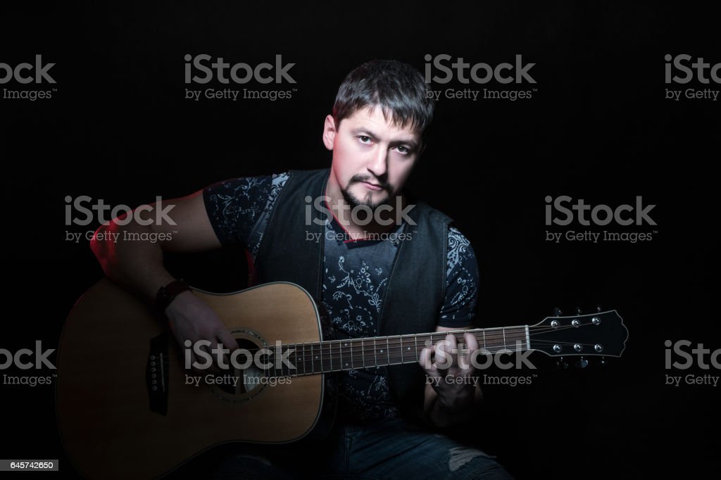 Portrait of a man with acoustic guitar stock photo