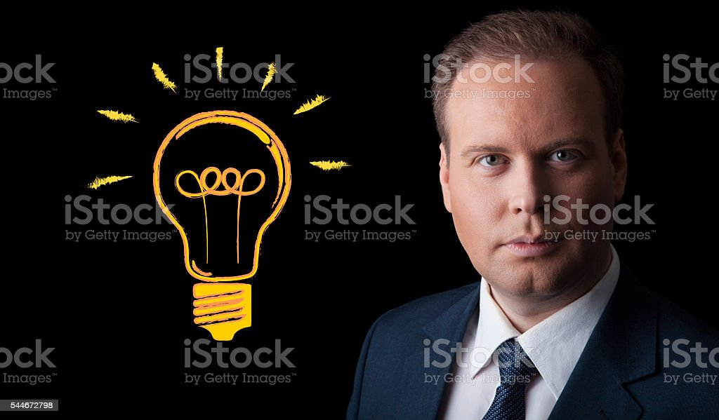portrait of a man with an idea on a black stock photo