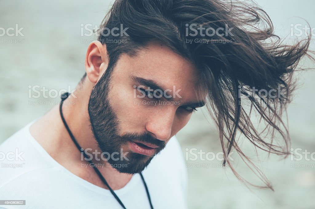 Portrait of a man with beard and modern hairstyle stock photo