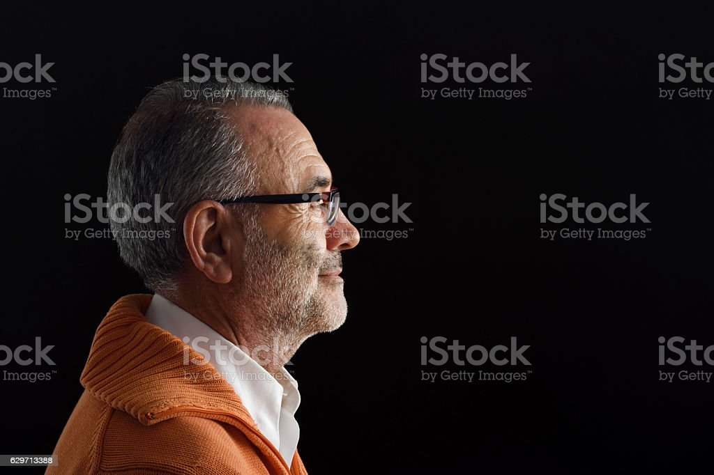 Portrait of a man with black background stock photo