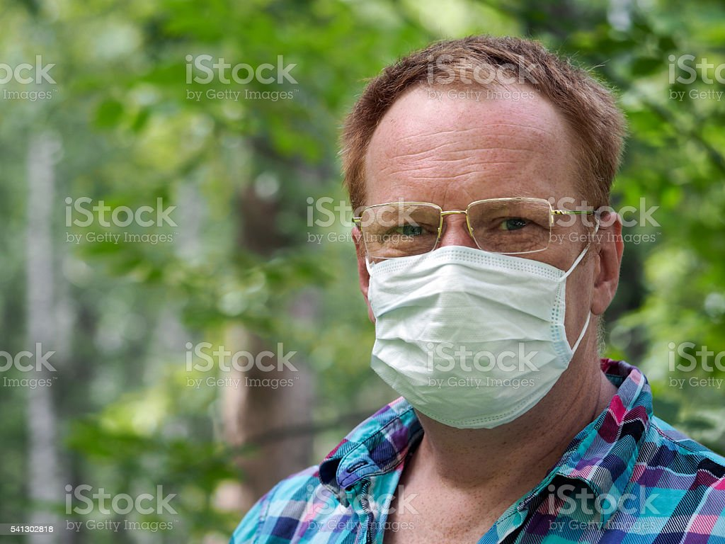 Portrait of a man with glasses and  medical mask stock photo