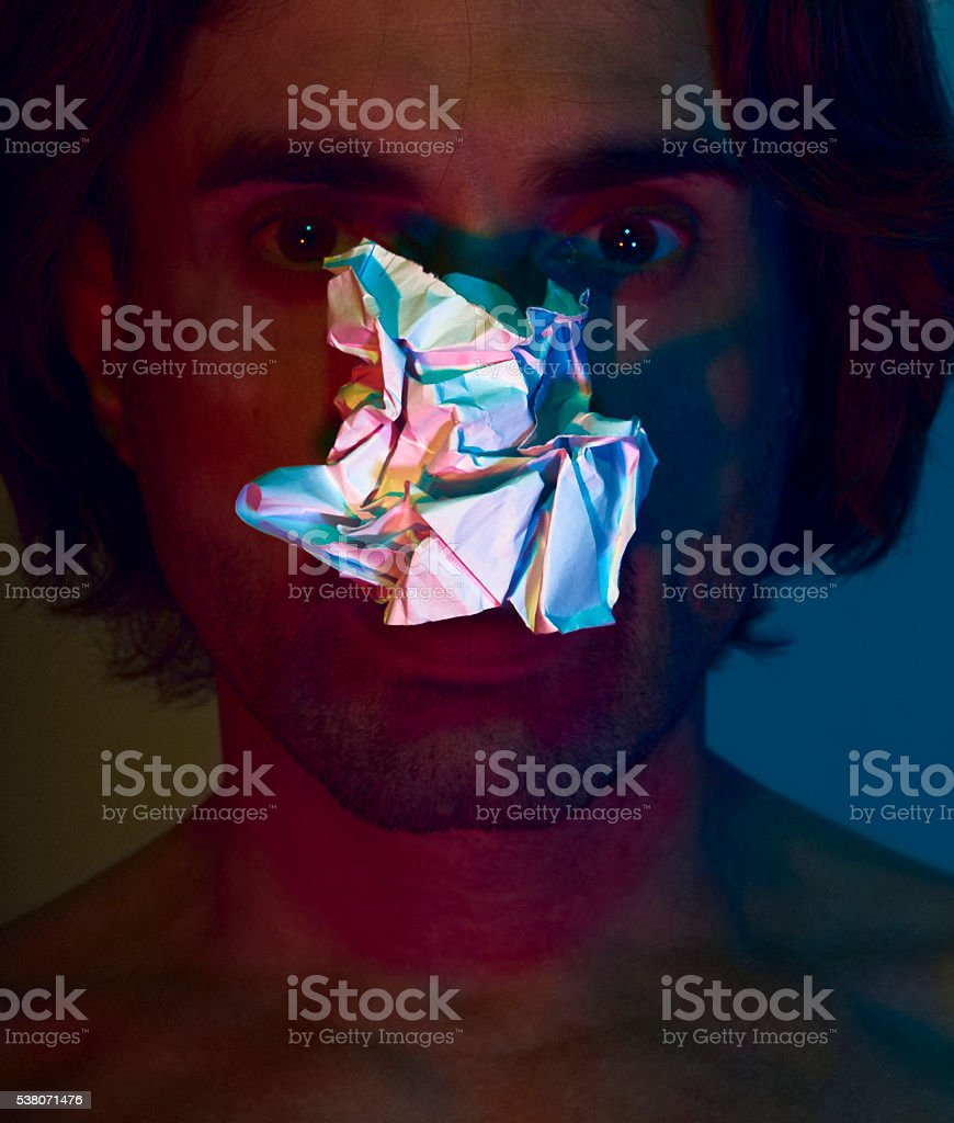 Portrait of a man with three coloured lights stock photo