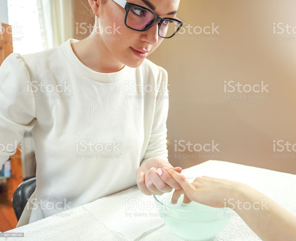 Portrait of a manicure during the process stock photo