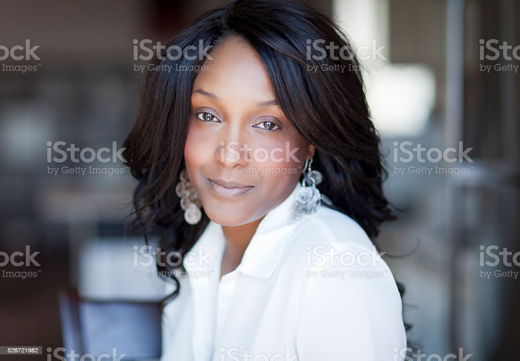 Portrait Of A Mature Black Woman Smiling At Home stock photo