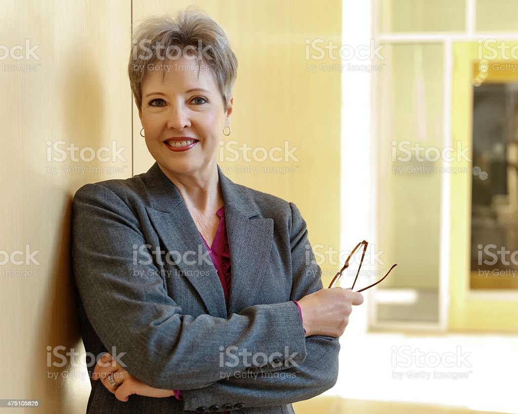 Portrait of a mature businesswoman in office interior. stock photo