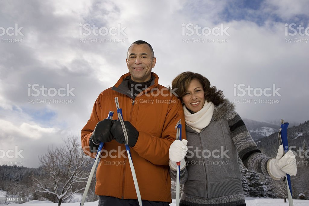 Portrait of a mature couple in the snow stock photo
