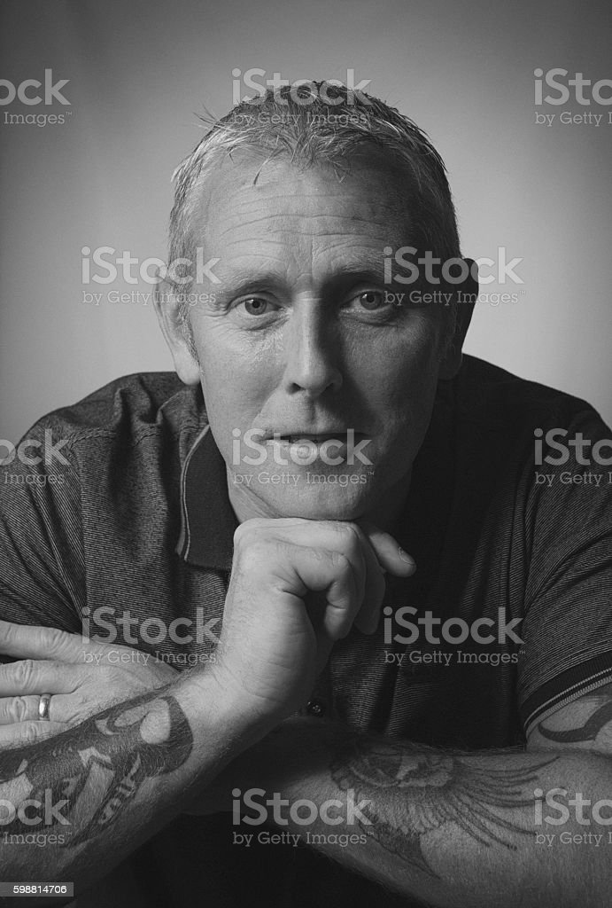 Portrait of a mature man looking into the camera. stock photo