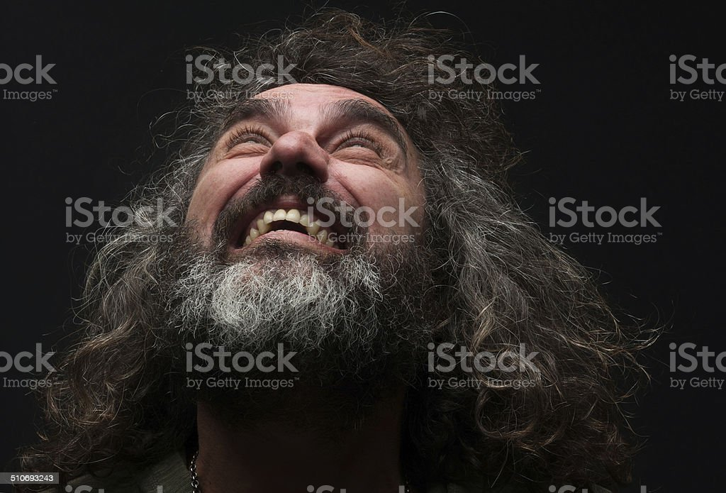 Portrait of a mature real man on black background. stock photo