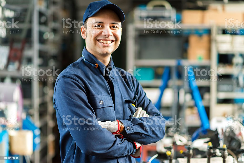 Portrait of a mechanic in his garage stock photo