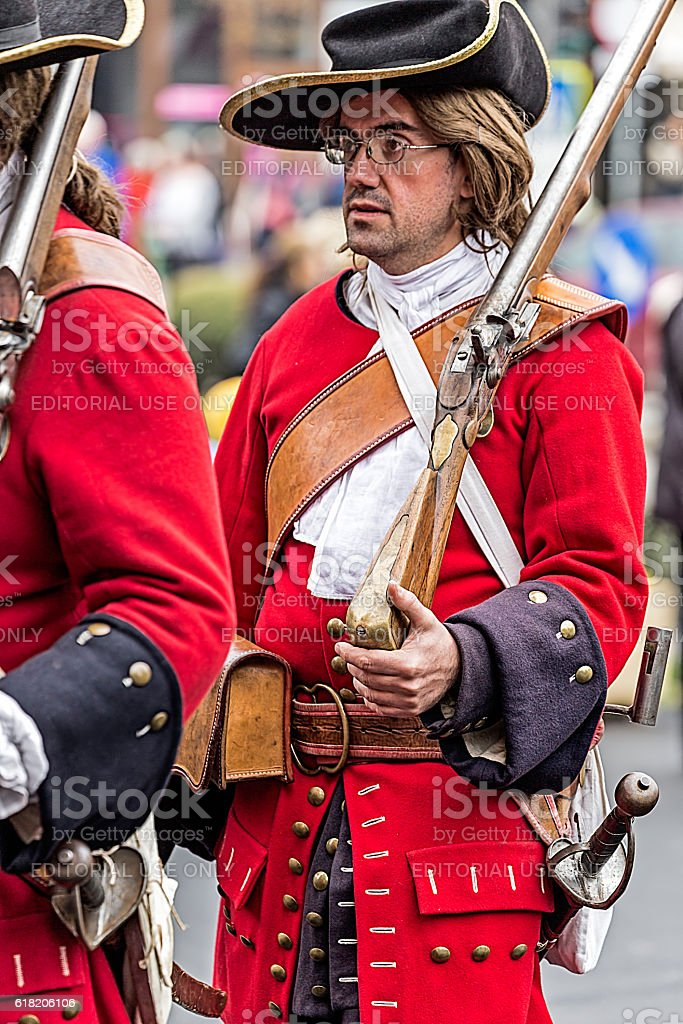 Portrait of a medieval soldier that marching on the street stock photo