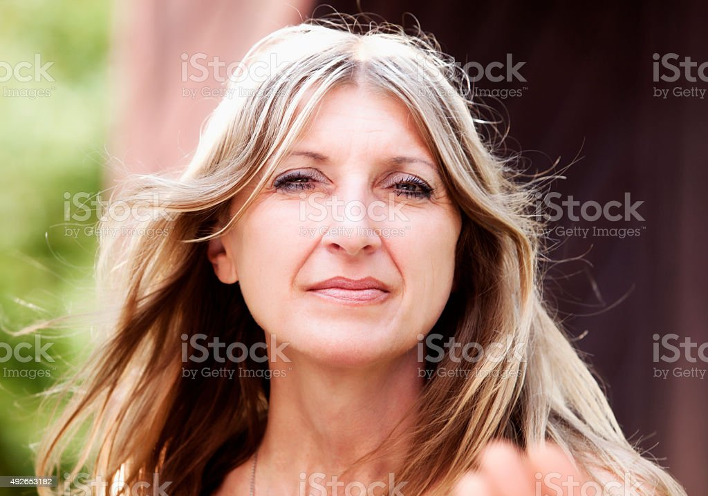 Portrait of a Middle-aged Woman with Blond Hair Looking stock photo
