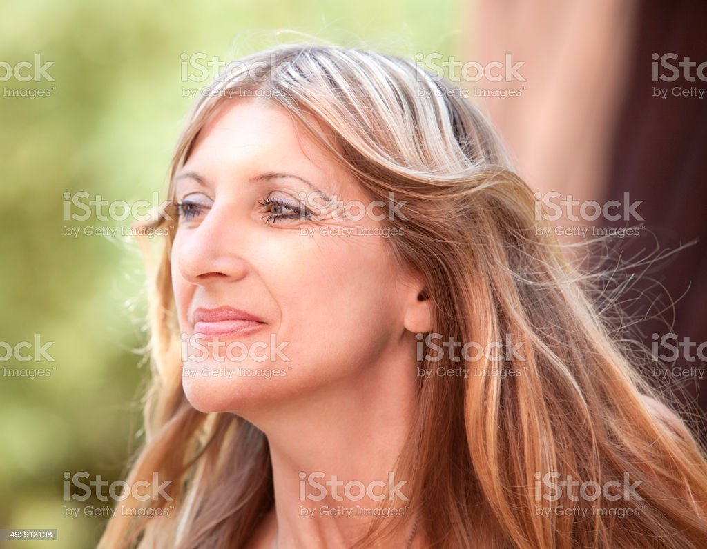 Portrait of a Middle-aged Woman with Blond Hair stock photo