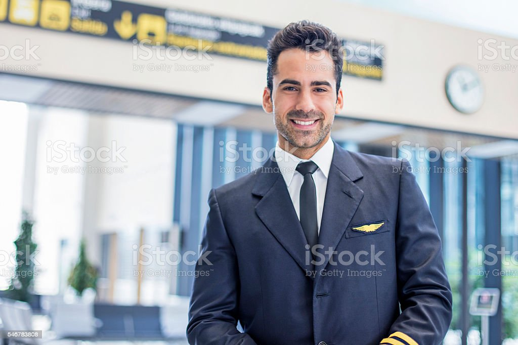 Portrait of a mide adult pilot waiting in the airport stock photo