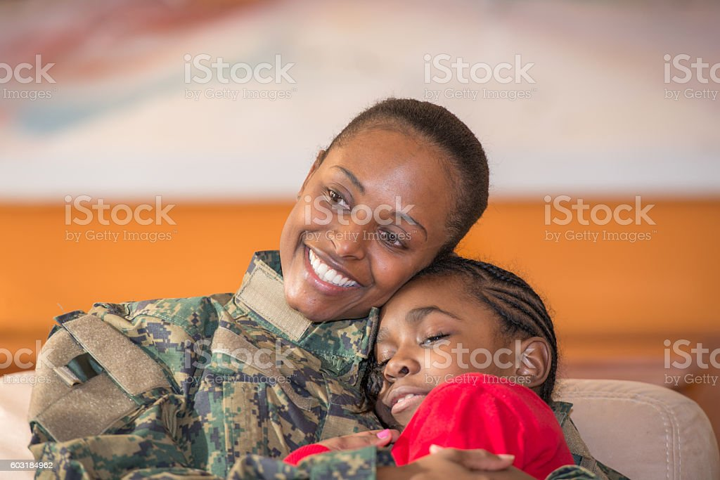 Portrait of a Military Mother Embracing her Daughter stock photo