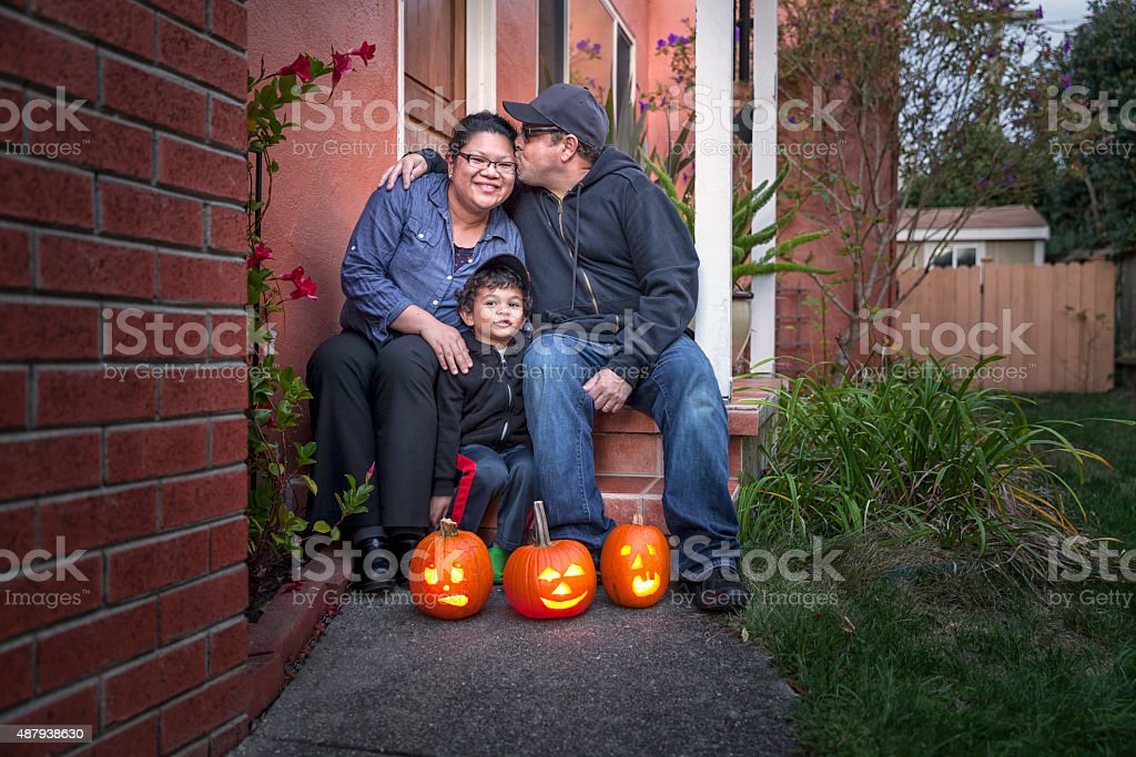 Portrait of a Modern Family at Home on Halloween stock photo