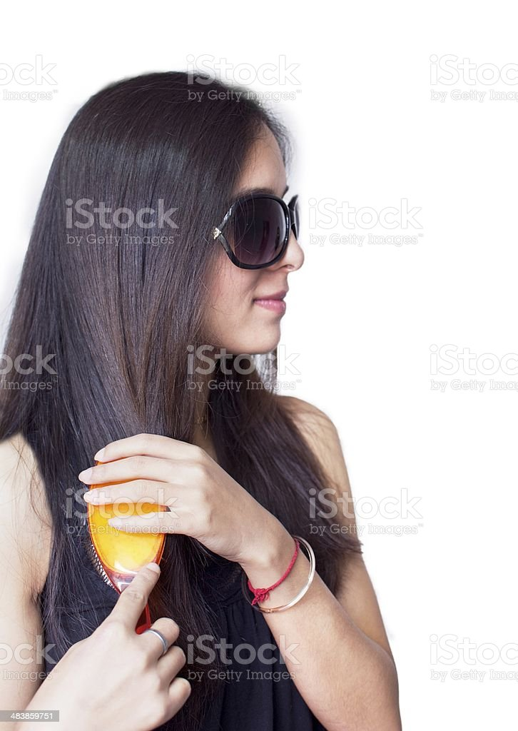 Portrait of a modern female brushing hairs. stock photo