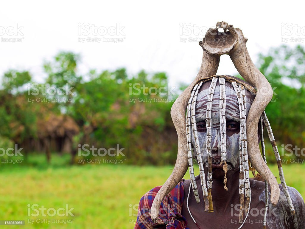 Portrait of a Mursi man with bone on his head royalty-free stock photo