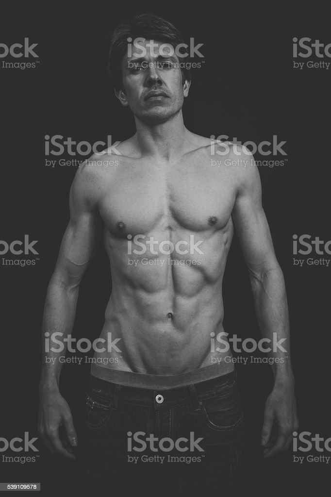 Portrait of a Muscular man in a studio stock photo