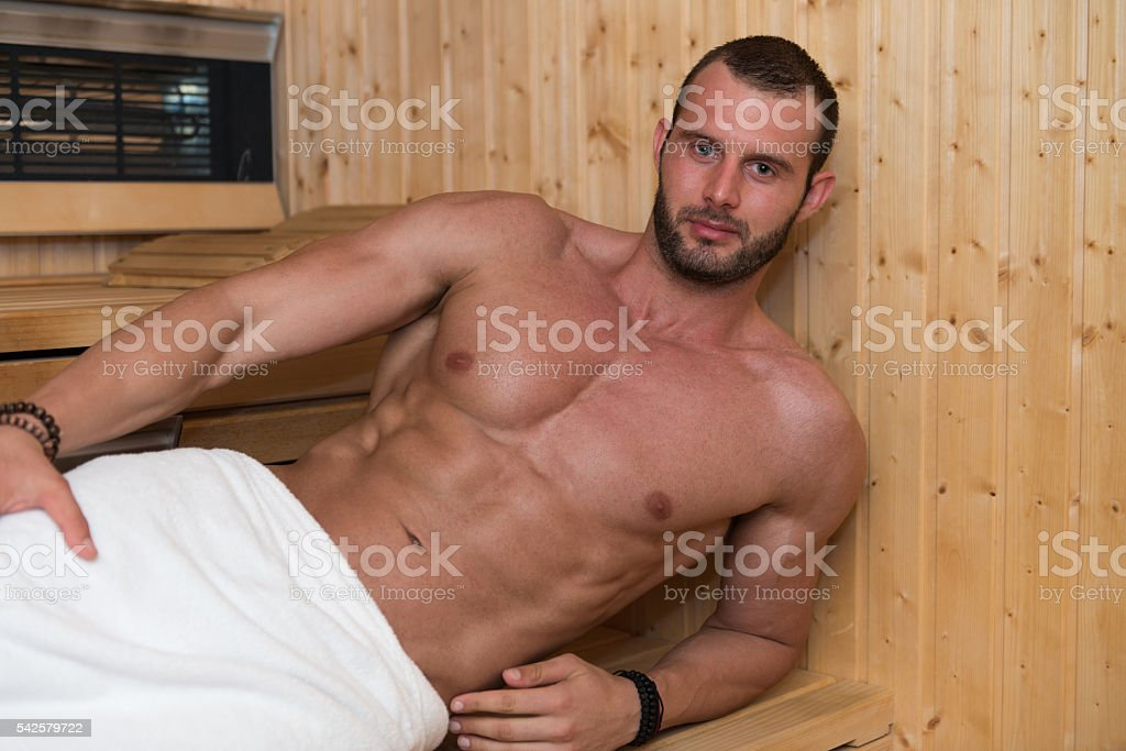Portrait Of A Muscular Man Relaxing In Sauna stock photo