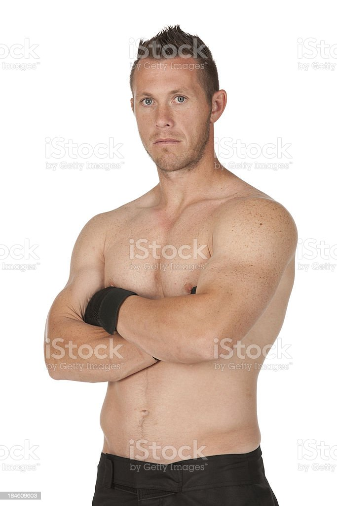Portrait of a muscular man with his arms crossed royalty-free stock photo