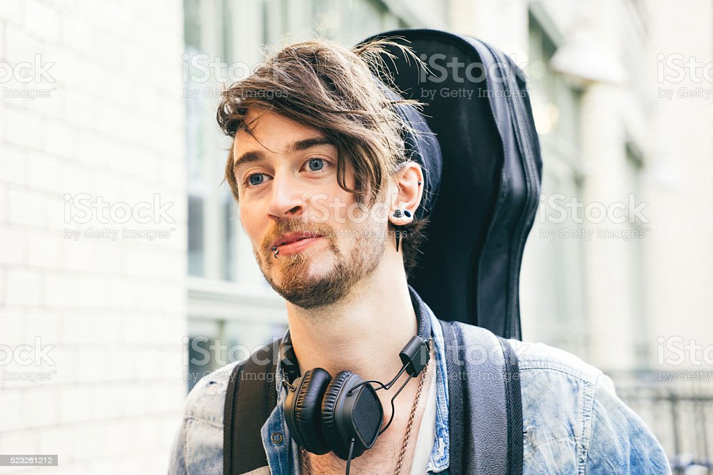 Portrait Of A Musician In Urban Landscape stock photo