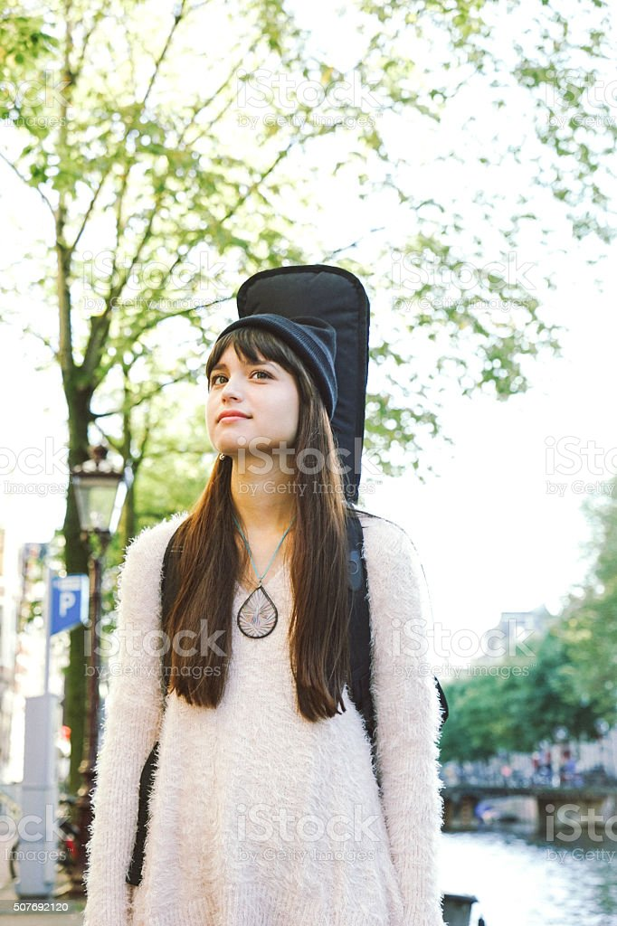 Portrait Of A Musician Walking Down The Street stock photo