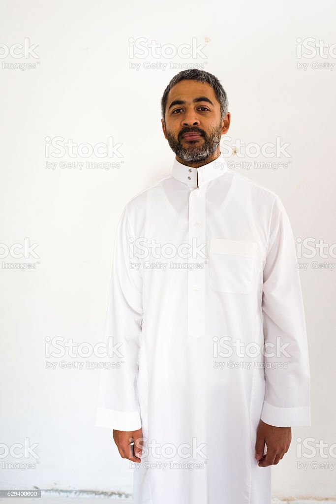 Portrait Of A Muslim Man In Traditional Dress stock photo