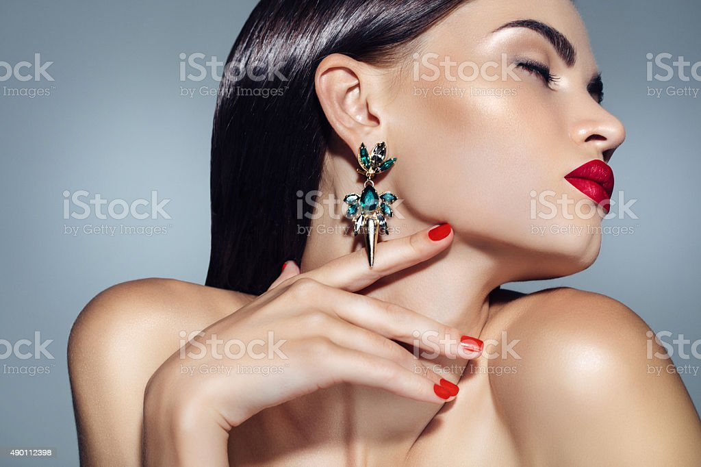 Portrait of a nice looking woman with beautiful earings stock photo
